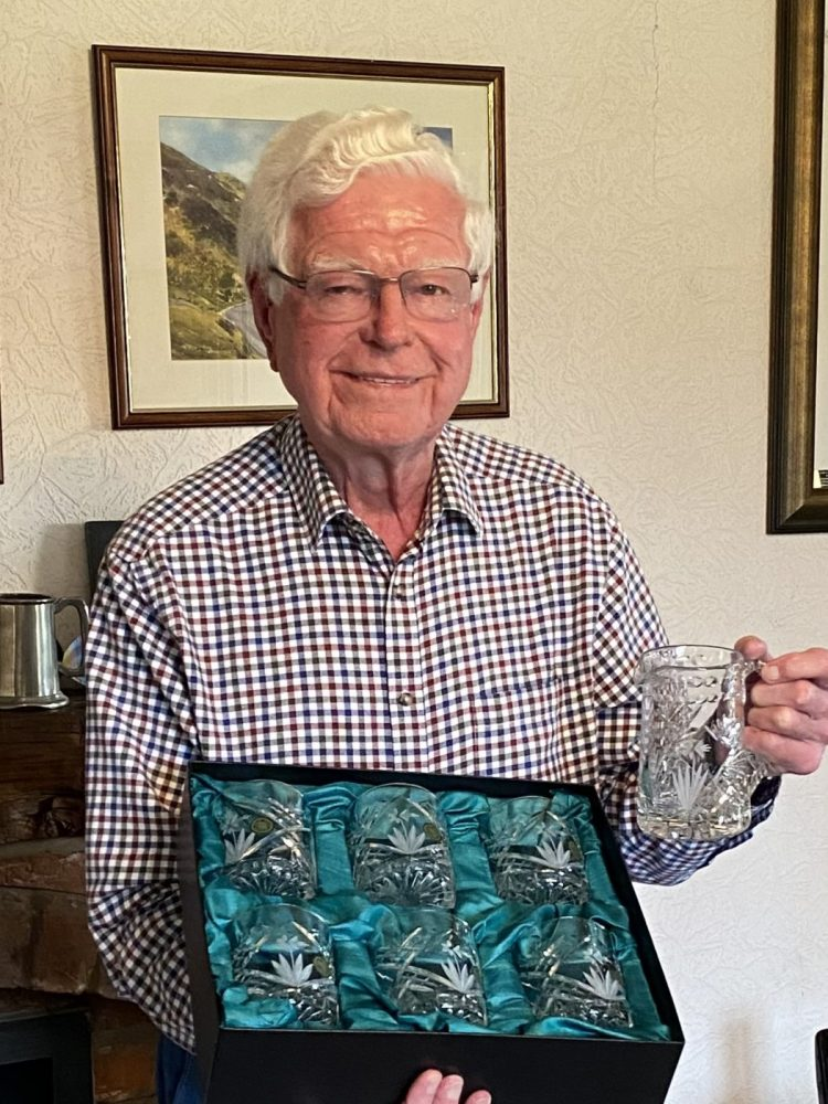 Aled presented with a set of Welsh crystal whisky glasses and an inscribed crystal jug, thanking him for his 39 years of service.