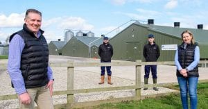 David Gibson with Moy Park employees at apoultry farm